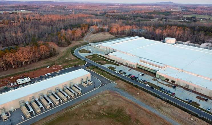 """The home of the iCloud: The Apple data center campus in Maiden, North Carolina, featuring a massive 500,000 square foot building (at right) supported by a smaller """"strategic"""" data center using modular data center technology. (Photo: Apple)"""